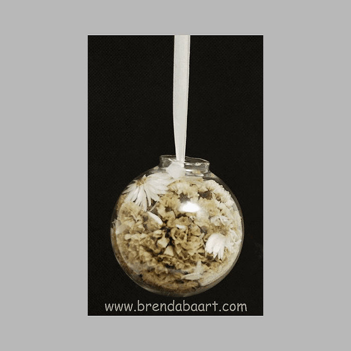 dried flowers in glass sphere