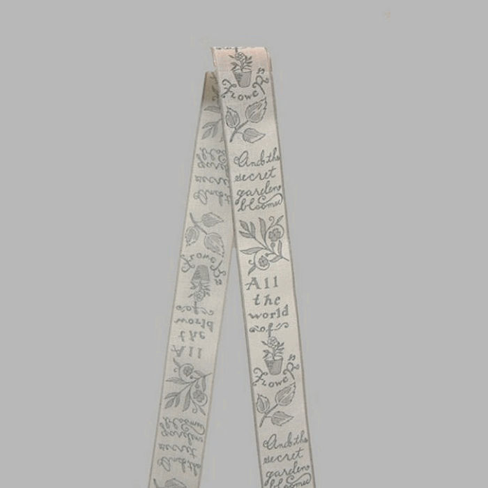 ribbon of fabric white grey flowers and text pattern width 40 mm